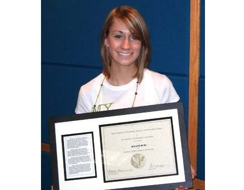McLaine Dury holding the 2009 APA Academic Achievement Award in Psychology