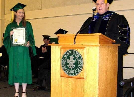 Charity Brown being presented The President's Award during graduation.