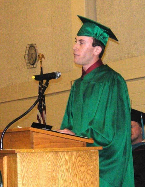 Ryan Davis giving speech during graduation.