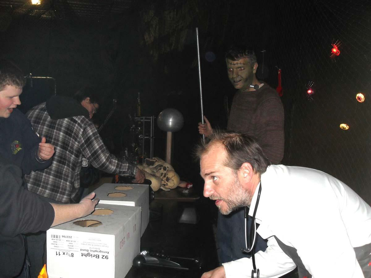 Professors Jeff Hucko and Dr. Ren Hartung in background participating in Haunted Forest event.