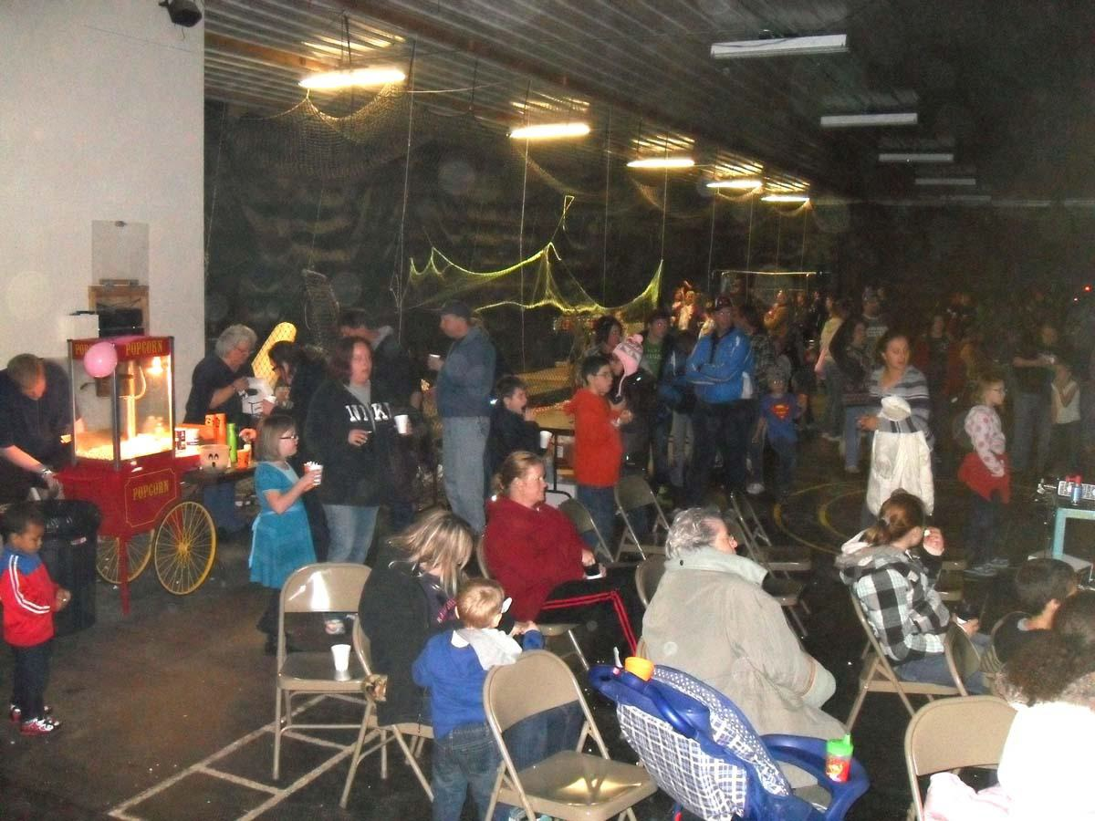 Haunted Forest event attendees in large room.