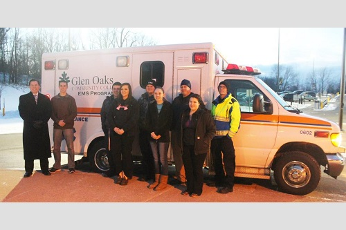 Representatives from LifeCare Ambulance Service, Michiana Health Care Education Center, Inc. and Glen Oaks join with students in the new Medical First Responder class as they get the first glimpse of the donated ambulance