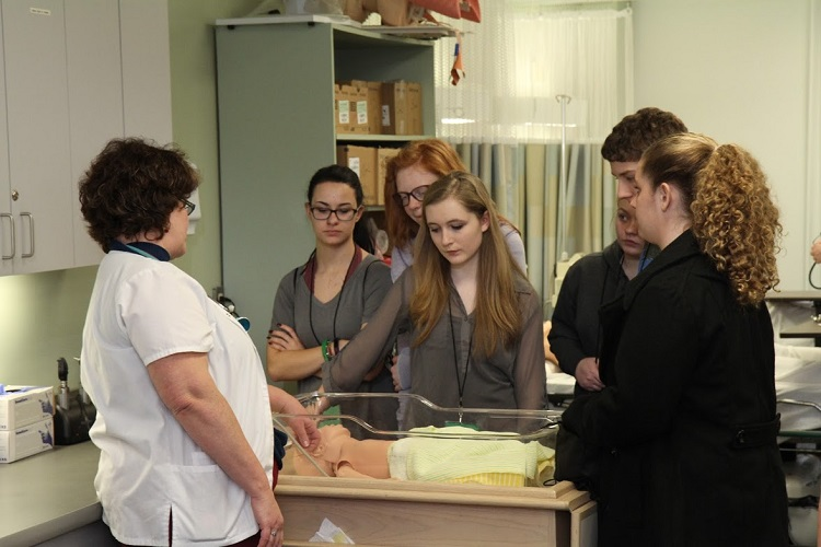 Students learn about taking care of infants in the Nursing Lab.