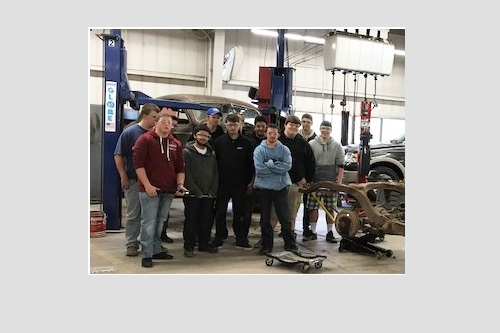 Group photo of students in the Auto Lab