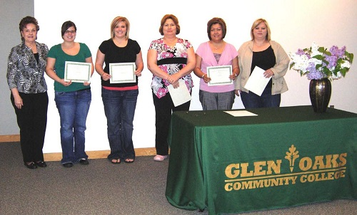Medical Assistant Club Leadership Award winners posing with awards.