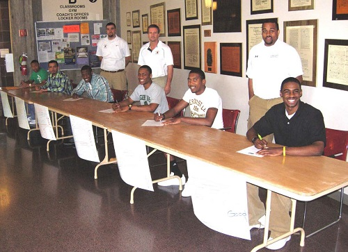 Basketball recruits signing Letters of Intent.