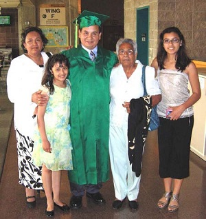 Rene Hernandez posing with his family in concourse after graduating.