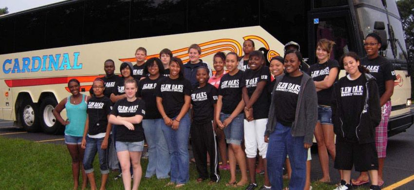 Upward Bound students in front of touring bus that traveled to colleges in Illinois.