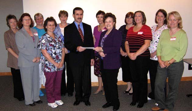 Dr. Wilson Sawa receiving Honorarium by Brenda Luczek with the Glen Oaks Medical Assistant Advisory Board present.