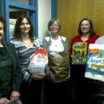 Medical Assistant Club showing off donations for local family in need.