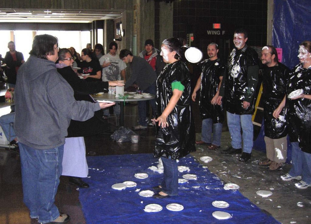 Sarah Simmons getting pie to face in GOCC concourse.