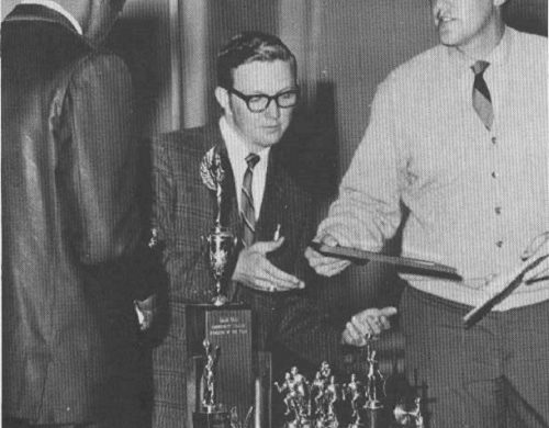 Coach Ken Schuler handing out trophies a long time ago.