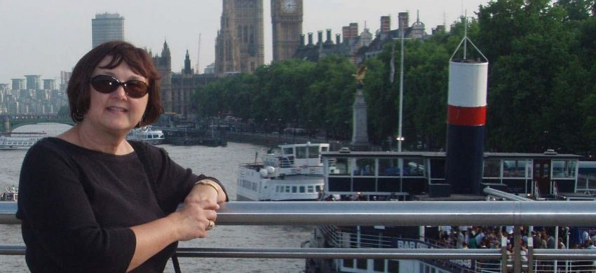 Professor Jeanne Reed posing over River Thames with Big Ben in the skyline.