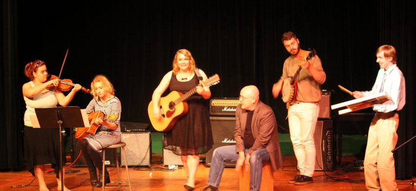 Chords in the Community performing on stage.