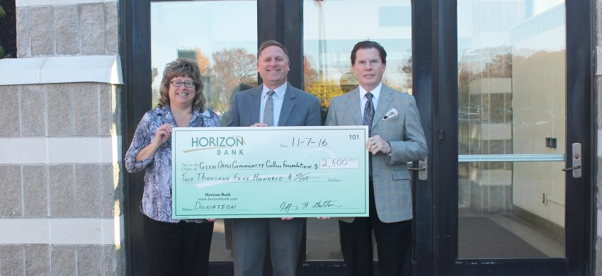 Pam Hughes, Jaff Gatton, and Dr. David Devier all holding giant check from Horizon Bank.