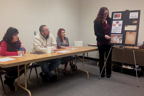 Graphic Design student presents in front of review panel