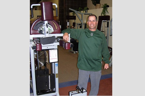 Keith Schreiber posing for photo in weight room.