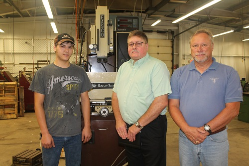 Vaupell's Zachary Wood, apprentice toolmaker, and Dennis Wood, tooling manager, pictured with Paul Aivars, GOCC's director of business services.
