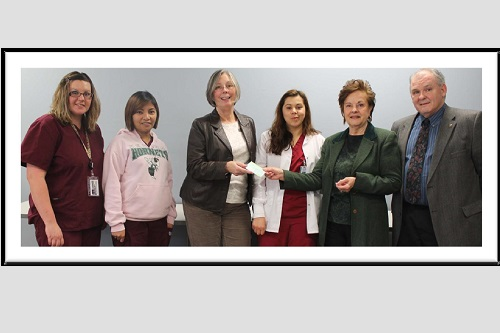 GOCC Allied Health members being presented a check from raising funds for Adopt-A-Family.