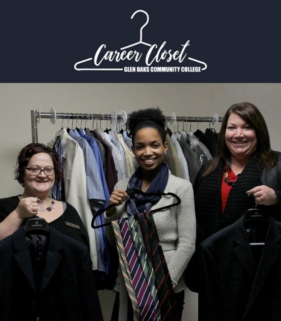 Staff holding up sample career clothes