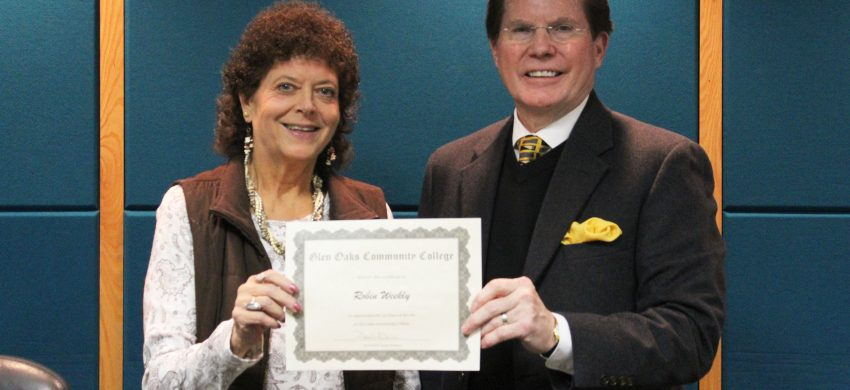 Robin Weekly, left, recently celebrated her 40-year service anniversary with Glen Oaks Community College. Presenting her certificate at a recent All-College meeting is Glen Oaks President David Devier.