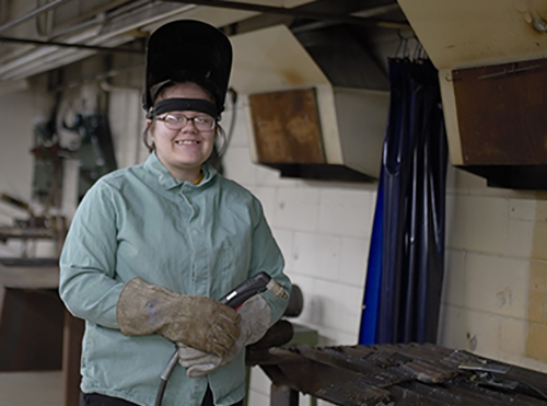 Kori Stroh with welding gear on