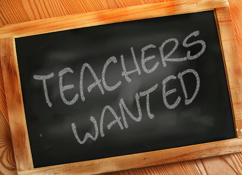 "Blackboard with words ""TEACHERS WANTED"""